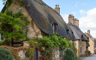 Why is insurance higher for thatched roof houses?